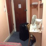 July 2014, room with on suite bathroom. Tea making facilities with kettle and the fan was a life
