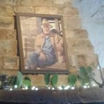 Inside Hondo's restaurant with a photo of Hondo Crouch.