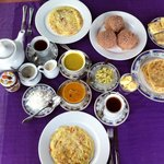 Delicious breakfast; fresh fruit plate, fruit juice, toast, rotti, egg rotti, string hoppers, ve