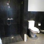 Bathroom with open shower facing the door