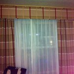 Curtain is made to only close this far, you can see through the other curtain so forget about th