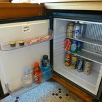 Small fridge with drinks