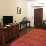 Large spacious rooms with wooden furniture