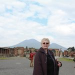 An ancient Pompei Plazza with Vesuvius view as background