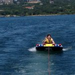 One of our sons tubing on the lake.
