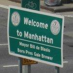 Manhattan sign just over the Williamsburg Bridge