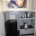 """Hidden"" amenities - mini fridge, coffee maker and safe (in drawer)."