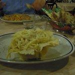 Spaghetti cacio e pepe (in a bowl of cheese)