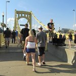 Jazz saxman playing for the people going over the bridge to PNC Park.