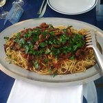 Spaghetti con sugo di polpo