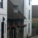 Moonraker in the narrow part (very narrow) of High Street  Alfriston, from the north