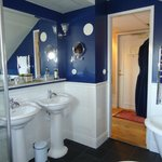 double sinks navy colored walls