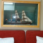 An antique model of a sailing ship in our room