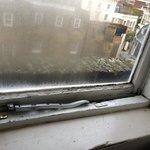 Broken, rotten window in top room.