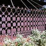 "fence made of ""leftover"" metal punch pieces"