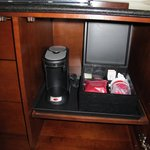 A coffeemaker is hidden in the cabinet.