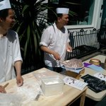 Making dumplings outside