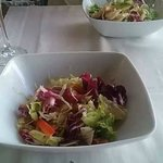 one salad comes full, one half empty...