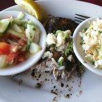 Mahi-mahi, hidden under bowls of cucumber salad and cole slaw