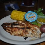 Delicious crab stuffed Mahi Mahi.  Served with boiled corn and potatoes.
