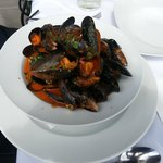 Fresh Mussels in tomato sauce and parsley