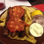 Kebab plate, with chips, grilled tomato, tzaziki and onions