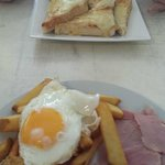 Brunch for two! Ham, egg n chips and thick melted cheese on toast
