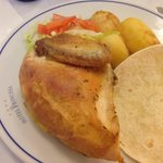 Half a chicken at lunch, salad and potatoes
