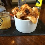Hot Pork Crackling with Apple Sauce, nice whilst you look over the menu
