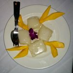 Dessert -  sliced mango and sticky rice drizzled with coconut cream sauce