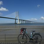 bike from Bikeiberia in front of Vasco de Gama bridge