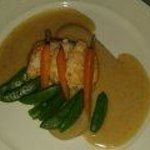 fish dish with lentil puree and vegetables