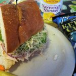 Sandwich on french bread and sprouts