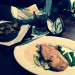 Great salmon on a bed of artichoke hearts and spinach with a side of the red potatoes