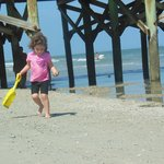 playing on the beach near the pier