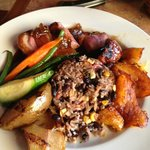 Roasted duck breast with fig glaze, sweet plantains,sub.  fajita vegetables
