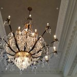 chandeliers hanging from the grand ballroom...