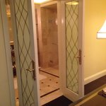 Beautiful glass French doors to the bathroom in the Parlor room. Absolutely worth the splurge