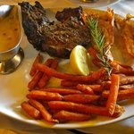 500gr chicago cut steak with mushroom sauce and sweet potato fries and 2 langoustines. perfect!