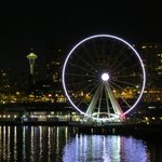 Ferris wheel and Space Needle at night
