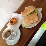 Hot roast pork on a delicious ciabatta roll with a coffee and the best Portuguese custard tart