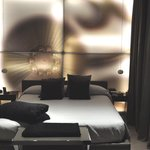 Bed with light-up wall behind