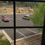 View out of window to back parking lot and hillside