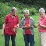 Myra, Karen and Cara with the flowers they picked in gardens for drawing  class.