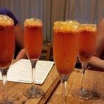 Four raspberry mimosas to celebrate!