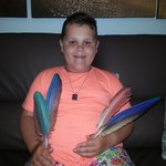 my son with the beautiful colourful parrot feathers the keeper retrieved from the enclosure espe