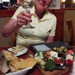 My wife enjoying the cheese tray, yum.
