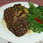 Grilled Charolais entrecote with herb butter and marinated vegetables