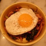Pig's ear with crispy kale, pickled cherry peppers & fried egg