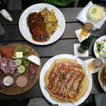 Mixed plate, pork and potatoes with sauerkraut. pancake with bacon plus salad.